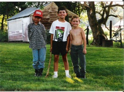 Alex (middle) with his cousins on the family farm.  He would later grow to well over 6 feet tall, but kept the same smile.  A man who could do it all- sports, climb mountains, ski, and even worked for NASA.